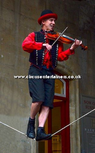 Violin Playing Tightwire Walker